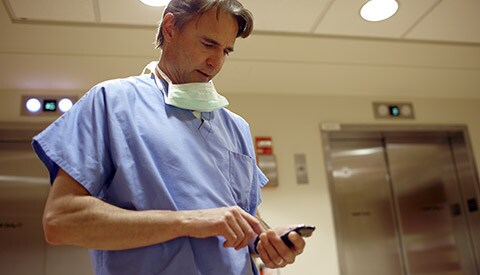 A clinician viewing patient records on a mobile device